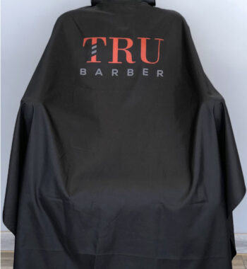 TRUBARBER PROFESSIONAL BARBER CAPE - Black With Red Letters